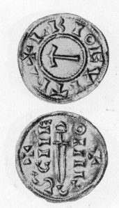 A VIKING COIN  showing Thor's hammer and a sword