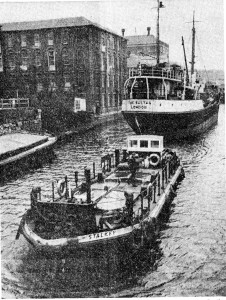 Sultan being towed out of Norwich by the tug Stalker.
