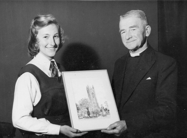 Canon Walter Lummis receiving a watercolour of St Mary's at the Chaucer Institute.
