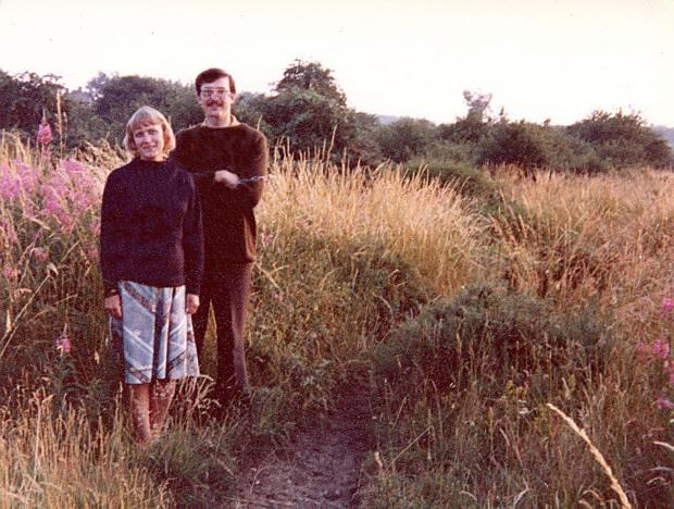 CHRISTINE SUTHERLAND AND JOE MASON, sloe thicket in background.