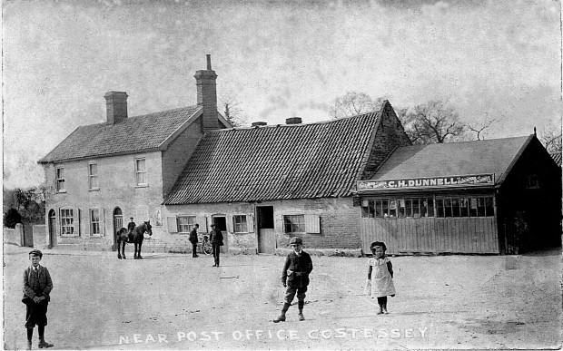 THE SMITH AT POST OFFICE PLAIN, COSTESSEY, circa 1908.