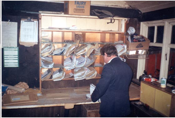 Tony Cork in the oils Post Office sorting shed.