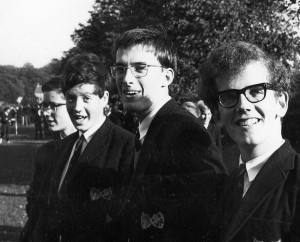 Pupils watching a Rugby match at Gresham's, 1966. Left to right, Chris Keith-Lucas, Stephen Barnard, Joe Mason and Giles Large.