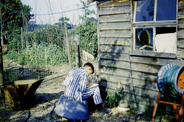 Me drawing a foxglove in the back garden at Poringland (about 1962)