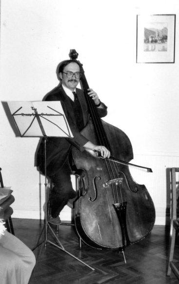 Joe Mason plays bass