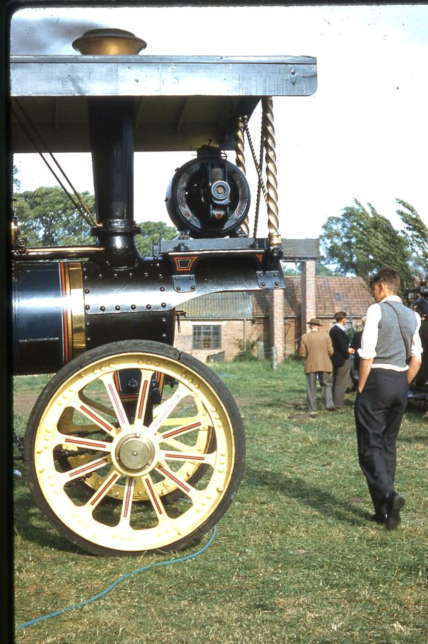 The electric generator mounted over the smokebox and the ornate twisted brass columns to support the roof canopy reveal this as a fairground engine.