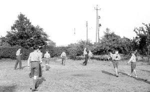 An unknown game on Crossways Beach; the apple trees are to the right.