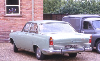 Eddie Cogman's green Ford Zodiac outside Framingham Earl Methodist chapel (which he built); the former chapel is now the hall adjoining it. 1964.