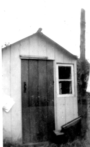 Lilac Cottage in 1957; it was painted pale green, with a dark green door.