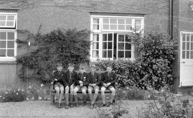 I am sitting one from the left between David Ratcliffe and 'Pooky' Woods; fourth from the left was Henry Burrows and last was (I think) Selwyn Harrold. Summer 1961.