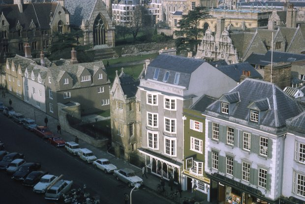 This unusual view of Blackwells in Broad Street was taken from the cupola of the Sheldonian Theatre. The block cottages to the left, which appear to be ancient, had recently been completely rebuilt.
