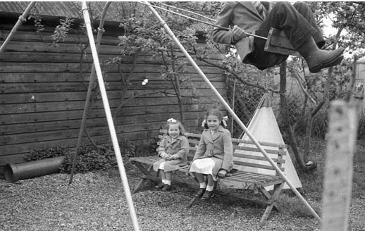 The Swing; Andrew Anderson is the headless person on it; the girls I do not remember.