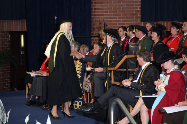 Polly receiving her degree